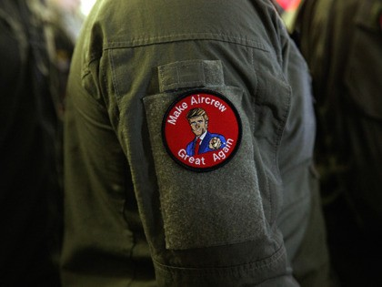 "A service member wears a patch that says ""Make Aircrew Great Again"" as they listen to President Donald Trump speak to troops at a Memorial Day event aboard the USS Wasp, Tuesday, May 28, 2019, in Yokosuka, Japan. The patch includes a likeness of Trump. (AP Photo/Evan Vucci)"