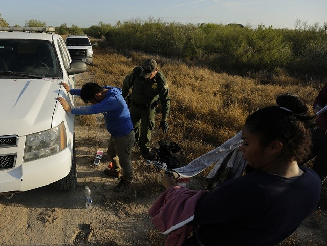 Border Patrol agents holds a group thought to have entered the country illegally, near McAllen, Texas, along the U.S.-Mexico border. In the Rio Grande Valley. (AP Photo/Eric Gay)