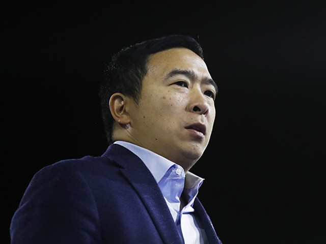 Democratic presidential candidate businessman Andrew Yang passes as he speaks at the McIntyre-Shaheen 100 Club Dinner, Saturday, Feb. 8, 2020, in Manchester, N.H. (AP Photo/Matt Rourke)