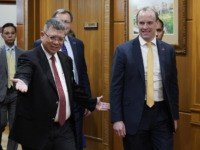 Malaysian Foreign Minister Saifuddin Abdullah, left, welcomes Britain's Foreign Secretary Dominic Raab at Foreign Ministry in Putrajaya, Malaysia, Tuesday, Feb. 11, 2020. (AP Photo/Vincent Thian)