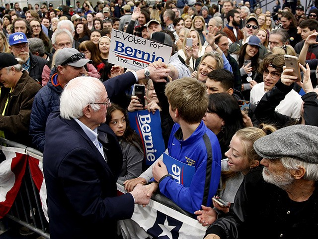 Democratic presidential candidate Sen. Bernie Sanders I-Vt.,shakes hands with supporters after his campaign event in Carson City, Nev.., Sunday, Feb. 16, 2020. (AP Photo/Rich Pedroncelli)
