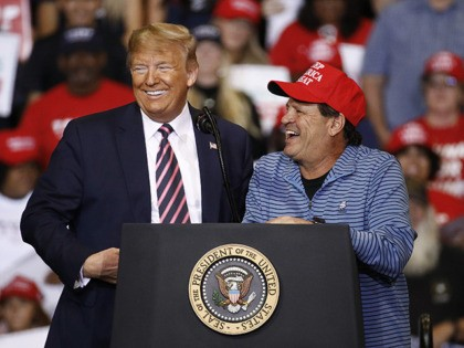 President Donald Trump speaks alongside Mike Eruzione, captain of the 1980 U.S men's Olympic hockey team, during a campaign rally, Friday, Feb. 21, 2020, in Las Vegas. (AP Photo/Patrick Semansky)