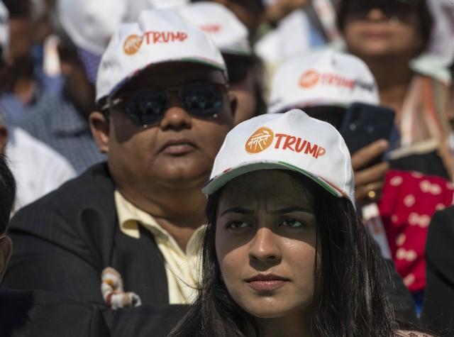"Spectators wear Trump hats as President Donald Trump and Indian Prime Minister Narendra Modi speak during a ""Namaste Trump,"" event at Sardar Patel Gujarat Stadium, Monday, Feb. 24, 2020, in Ahmedabad, India. (AP Photo/Alex Brandon)"