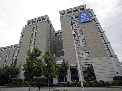This Thursday, Sept. 12, 2013, photo shows the Children's Hospital Medical Center, in Cincinnati. The Medical center says it can't accept federal money to help sign people up for insurance under President Barack Obama's health care law because of new state restrictions. (AP Photo/Al Behrman)