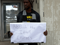 "DES MOINES, IOWA - FEBRUARY 04: Local resident Wallace Mazon holds a sign outside the Iowa Democratic Party headquarters February 4, 2020 in Des Moines, Iowa. The announcement of the results in the Iowa presidential caucuses has been delayed after ""inconsistencies"" were found late Monday night relating to the app …"
