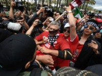 Anti-Trump protesters (L) clash with Donald Trump supporters (C) outside the Anaheim Convention Center during a rally for Republican presidential candidate Donald Trump on May 25, 2016 in Anaheim, California. Police were on high alert one day after violence marred a Trump rally in the southwestern state of New Mexico, …
