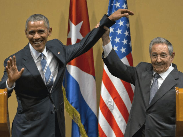 In this March 21, 2016 file photo, Cuban President Raul Castro, right, lifts up the arm of U.S. President Barack Obama, at the conclusion of their joint news conference at the Palace of the Revolution, in Havana, Cuba. The United States will vote this week against an annual United Nations …