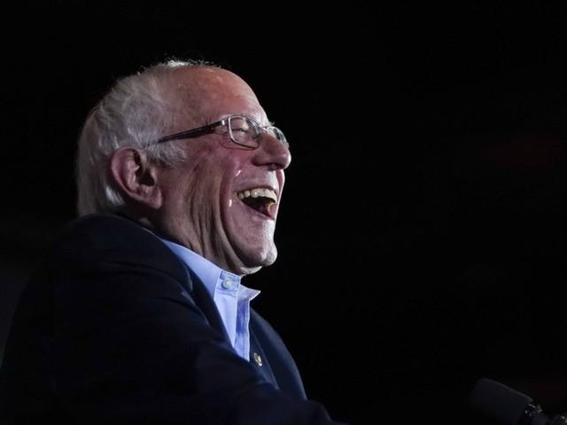 Bernie Sanders laughs triumphant (Drew Angerer / Getty)