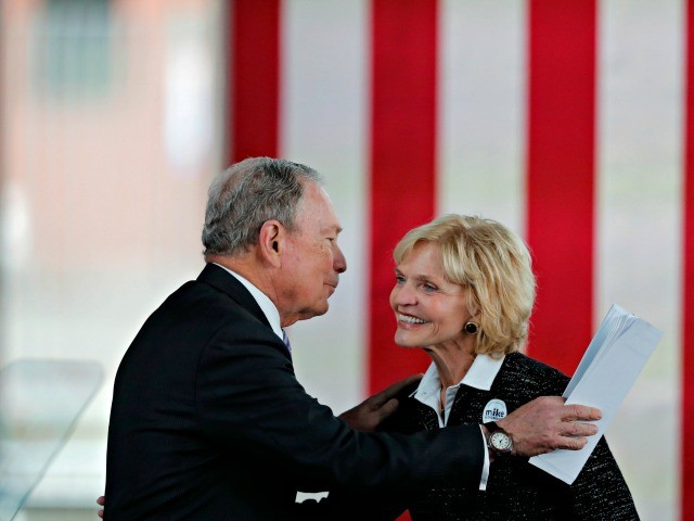 Democratic presidential candidate and former New York City Mayor Mike Bloomberg greets former North Carolina Gov. Beverly Purdue as he arrives to speak at a campaign event in Raleigh, N.C., Thursday, Feb. 13, 2020. (AP Photo/Gerald Herbert)