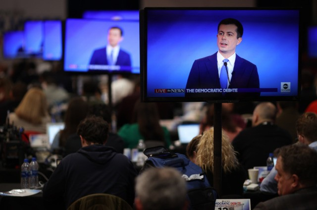 MANCHESTER, NEW HAMPSHIRE - FEBRUARY 07: Journalists watch from the press filing center as Democratic presidential candidates participate in a Democratic presidential primary debate in the Sullivan Arena at St. Anselm College on February 07, 2020 in Manchester, New Hampshire. Seven candidates qualified for the second Democratic presidential primary debate …