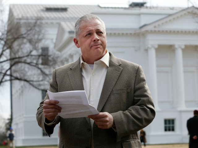 Republican candidate for Virginia governor, Denver Riggleman, reads from a statement during a news conference at the Capitol in Richmond, Va., Tuesday, Jan. 31, 2017. Riggleman addressed the killing of bill that would bar political contributions from regulated monopolies. (AP Photo/Steve Helber)