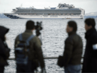 A TV crew film a cruise ship Diamond Princess anchoring off the Yokohama Port Tuesday, Feb. 4, 2020, in Yokohama, near Tokyo. Japanese health officials are conducting extensive medical checks on all 3,700 passengers and crew of the cruise ship that returned to the country after one passenger tested positive …