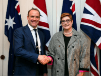 Australia's Foreign Minister Marise Payne (R) shakes hands with Britain's Foreign Secretary Dominic Raab (L) prior to their bilateral meeting at Parliament House in Canberra on February 6, 2020. - Raab is on a two-day official visit to hold talks on bilateral issues with Australian officials. (Photo by LUKAS COCH …