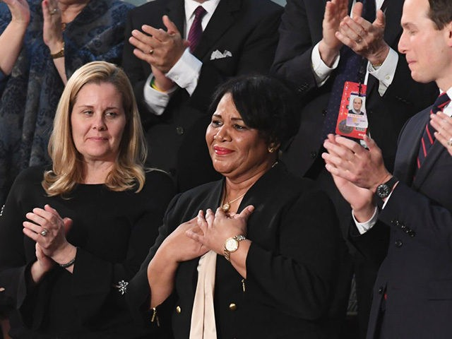 Alice Johnson (C), one of the US President's special guests, reacts as the president acknowledges her during his State of the Union address at the US Capitol in Washington, DC, on February 5, 2019. (Photo by SAUL LOEB / AFP) (Photo credit should read SAUL LOEB/AFP via Getty Images)