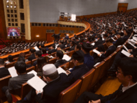 Deputies of the National People's Congress (NPC) listen to President of the Supreme People's Court Zhou Qiang's speech on the work of the Supreme People's Court during the third plenary meeting of the NPC at The Great Hall Of The People on March 12, 2019 in Beijing, China. (Photo by …