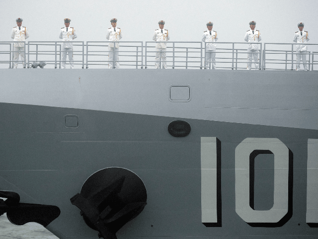 Sailors stand on the deck of the new type 055 guide missile destroyer Nanchang of the Chinese People's Liberation Army (PLA) Navy as it participates in a naval parade to commemorate the 70th anniversary of the founding of China's PLA Navy in the sea near Qingdao, in eastern China's Shandong …