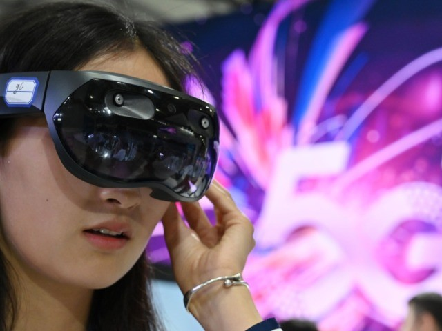A woman tries out a Huawei augmented reality headset during the Mobile World Congress (MWC 2019) introducing next-generation technology at the Shanghai New International Expo Centre (SNIEC) in Shanghai on June 27, 2019. (Photo by HECTOR RETAMAL / AFP) (Photo credit should read HECTOR RETAMAL/AFP via Getty Images)