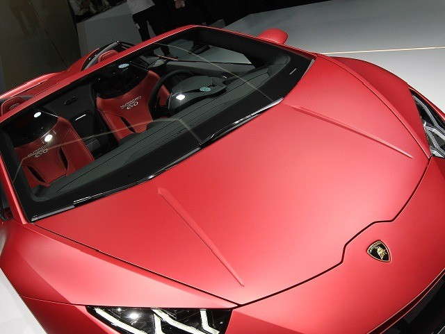 A Lamborghini Huracan Evo Spyder car is displayed at the company's booth at the International Auto Show (IAA), in Frankfurt am Main, on September 11, 2019. - Frankfurt's biennial International Auto Show (IAA) opens its doors to the public on September 12, 2019, but major foreign carmakers are staying away …