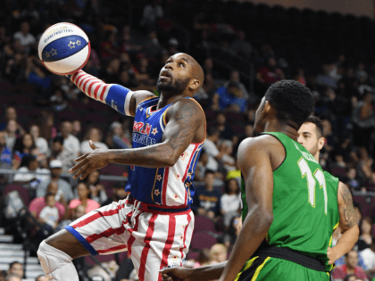 """Carlos """"Dizzy"""" English #2 of the Harlem Globetrotters drives against Shaquille Burrell #11 of the Washington Generals during their exhibition game at the Orleans Arena on August 25, 2019 in Las Vegas, Nevada. (Photo by Ethan Miller/Getty Images)"""