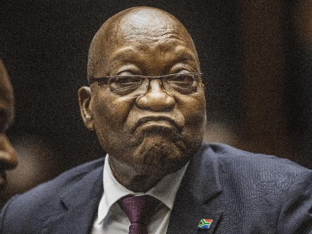 South Africa's embattled former president Jacob Zuma (C) in the Pietermaritzburg High Court where he is appearing on corruption charges, in what would be the first time he faces trial for graft despite multiple accusations, in Pietermaritzburg on October 15, 2019. - Zuma stands accused of taking kickbacks before he …
