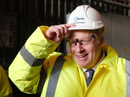 "MIDDLESBROUGH, ENGLAND - NOVEMBER 20: Prime Minister Boris Johnson wears a construction helmet with ""Prime Minister"" written on it, during a visit to Wilton Engineering Services as part of a General Election campaign trail stop on November 20, 2019 in Middlesbrough, England. (Photo by Frank Augstein - WPA Pool/Getty Images)"
