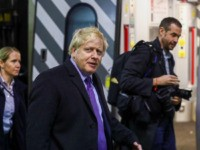 MILTON KEYNES, UNITED KINGDOM - DECEMBER 4: Britain's Prime Minister Boris Johnson walks along the platform at Euston train station after an election campaign visit to Red Bull Racing on December 4, 2019 in Milton Keynes, England. The UK will go to the polls on December 12, the third General …