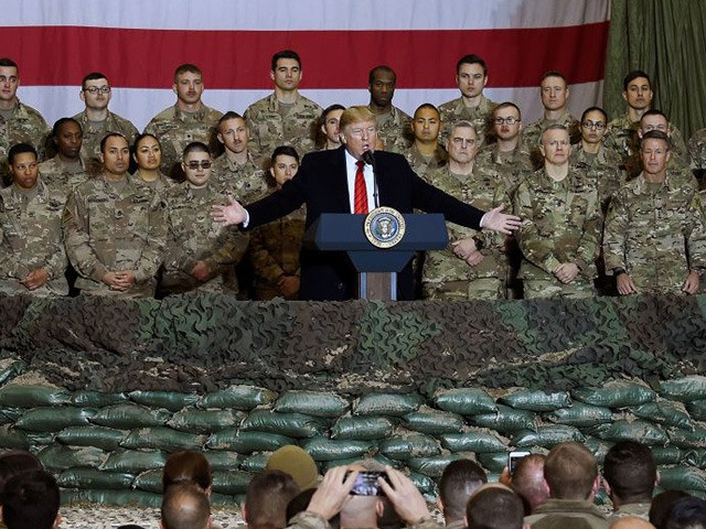 (FILES) In this file photo taken on November 28, 2019, US President Donald Trump speaks to the troops during a surprise Thanksgiving day visit at Bagram Air Field in Afghanistan. - President Donald Trump has shattered through norms and niceties on the world stage in his nearly three years in …
