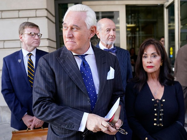 WASHINGTON, DC - NOVEMBER 15: Former advisor to U.S. President Donald Trump, Roger Stone (2nd L), departs the E. Barrett Prettyman United States Courthouse with his wife Nydia (R) after being found guilty of obstructing a congressional investigation into Russia's interference in the 2016 election on November 15, 2019 in …