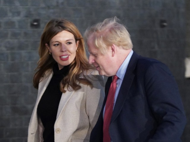 LONDON, ENGLAND - DECEMBER 13: Prime Minister Boris Johnson and his partner Carrie Symonds enter Downing Street as the Conservatives celebrate a sweeping election victory on December 13, 2019 in London, England. Prime Minister Boris Johnson called the first UK winter election for nearly a century in an attempt to …