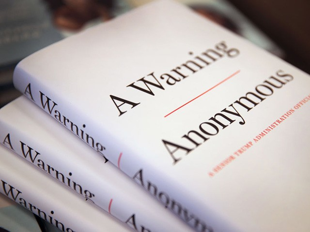 """CHICAGO, ILLINOIS - NOVEMBER 19: Copies of """"A Warning"""" by Anonymous are offered for sale at a Barnes & Noble store on November 19, 2019 in Chicago, Illinois. The book, written by an author claiming to be a senior Trump administration official, is billed as an inside look at dysfunction …"""