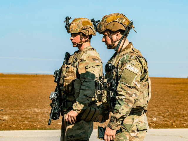 US soldiers look on as they patrol the village of al Jawadiyah in the northeastern Hasakeh province, near the border with Turkey, on January 22, 2020. (Photo by Delil SOULEIMAN / AFP) (Photo by DELIL SOULEIMAN/AFP via Getty Images)