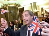 Britain's Brexit Party leader Nigel Farage waves a Union flag as he speaks to the press after the European Parliament ratified the Brexit deal in Brussels on January 29, 2020. - The European Parliament on January 29 voted overwhelmingly to approve the Brexit deal with London, clearing the final hurdle …