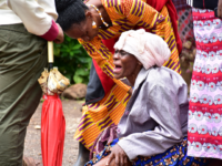 Moshi residents in Kilimanjaro region, north Tanzania, grieve at Mawenzi hospital on February 2, 2020, after the death of her granddaughter who was killed in stampede yesterday at Majengo open ground during the church service where 20 people died and 16 injured rushed to get blessed oil. (Photo by FILBERT …