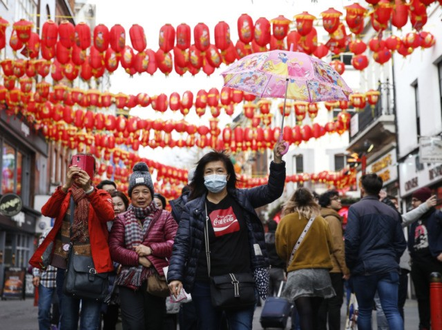 LONDON, ENGLAND - FEBRUARY 02: A woman wears a face mask in Chinatown on February 2, 2020 in London, England. There are currently 2 confirmed cases of Coronavirus in the UK.(Photo by Hollie Adams/Getty Images)