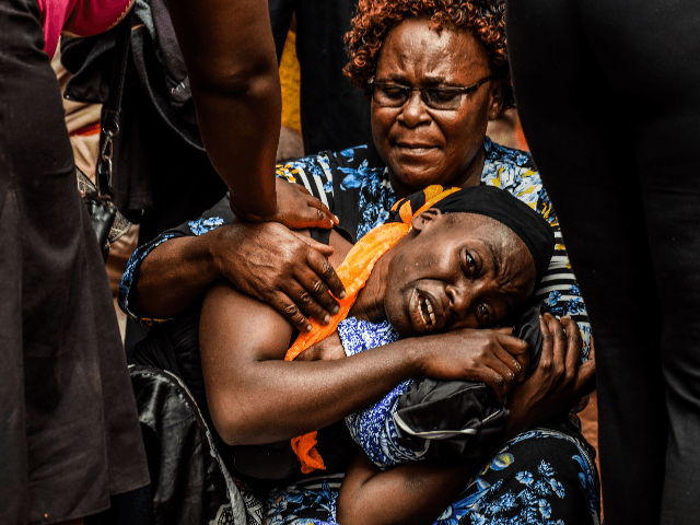 A mother mourns for her dead child at Kakamega Hospital mortuary in western Kenya on February 4, 2020. - 14 pupils lost their lives while 39 others were injured following a stampede at Kakamega Primary School on 3rd February 2020 as the pupils rushed to get home according to the …