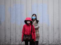 Pedestrians wear facemasks as they prepare to cross a road in Hong Kong on February 4, 2020, as a preventative measure following a virus outbreak which began in the Chinese city of Wuhan. - Hong Kong on February 4 became the second place outside mainland China to report the death …