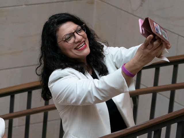 WASHINGTON, DC - FEBRUARY 04: (L-R) U.S. Reps. Madeline Dean (D-PA), Sylvia Garcia (D-TX), Debbie Mucarsel-Powell (D-FL) and Rashida Tlaib (D-MI) pose for a selfie as they wait for a group photo with members of the Democratic Women's Caucus prior to State of the Union address at the U.S. Capitol …