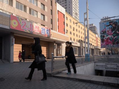 In a photo taken on February 8, 2020 people walk on a street in Pyongyang. (Photo by KIM Won Jin / AFP) (Photo by KIM WON JIN/AFP via Getty Images)