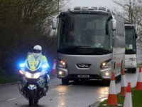 A convoy of coaches carrying British nationals evacuated from Wuhan in China amid the novel coronavirus outbreak, arrives at Kents Hill Park conference centre and hotel in Milton Keynes, north of London on February 9, 2020, where they will be kept in isolation and monitored for 2019-nCoV strain of the …