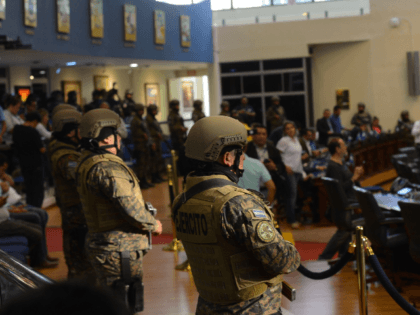 Members of the Salvadoran Armed Forces are seen within the Legislative Assembly during a protest outside the Legislative Assembly to make pressure on deputies to approve a loan to invest in security, in San Salvador on February 9, 2020. (Photo by STR / AFP) (Photo by STR/AFP via Getty Images)