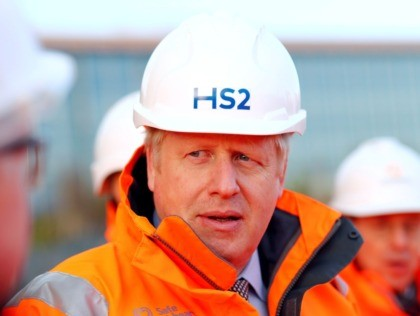 Britain's Prime Minister Boris Johnson reacts during his visit to Curzon Street railway station in Birmingham, central England on February 11, 2020, where the High Speed 2 (HS2) rail project is under construction. - Britain said Tuesday it will begin full construction work on its new high-speed railway line in …