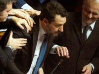 Lega members Gian Marco Centinaio (L) and Roberto Calderoli (R) congratulate Italian Lega party far-right leader Matteo Salvini after he addressed the Senate on February 12, 2020 in Rome, as Italian senators are to decide whether he should face trial on charges of illegally detaining migrants at sea last year. …