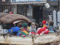 Syrians drive with their belongings as they flee the town of Atme in Syria's northwestern Idlib province, near the Turkish border, on February 12, 2020, following a weeks-long regime offensive against the country's last major rebel bastion. (Photo by Rami al SAYED / AFP) (Photo by RAMI AL SAYED/AFP via …