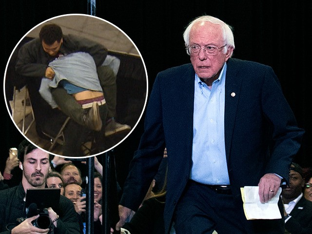 (INSET: Video of fight) Democratic presidential candidate Vermont Senator Bernie Sanders walks onto the stage at the beginning of a campaign rally in Denver, Colorado on February 16, 2020. (Photo by Jason Connolly / AFP) (Photo by JASON CONNOLLY/AFP via Getty Images)