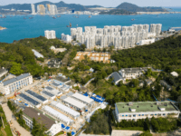 An aerial photo shows Lei Yue Mun Park and Holiday Village, the city's largest quarantine site, which is being used to house people identified as having contact with confirmed cases of the COVID-19 coronavirus, in Hong Kong on February 17, 2020. (Photo by Anthony WALLACE / AFP) (Photo by ANTHONY …