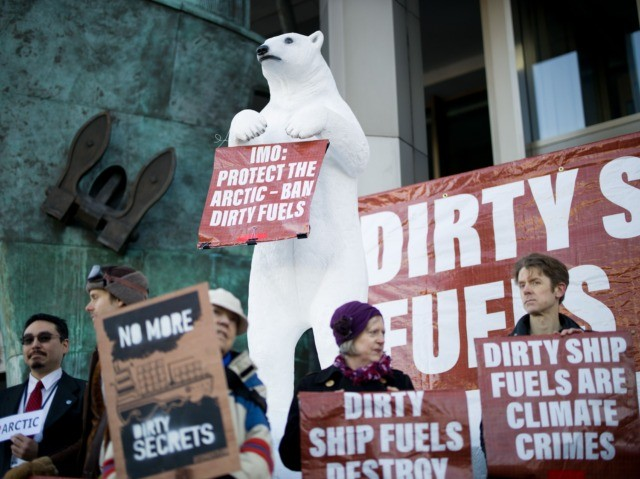 Activists from the Extinction Rebellion climate action group protest outside the International Maritime Organisation in London on February 17, 2020 against pollution in the Arctic due to the global shipping industry as delegates meet for the International Maritime Organizations week long Pollution Prevention & Response sub-committee (PPR7) meeting. (Photo by …