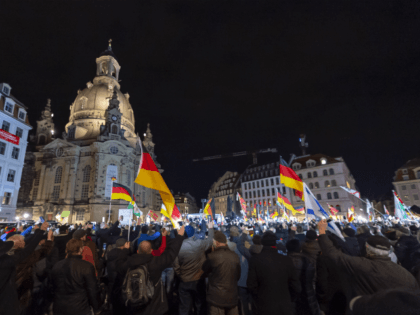 "DRESDEN, GERMANY - FEBRUARY 17: Supporters of the anti-Muslim Pegida movement join the 200th meeting of Pegida, February 17, 2020, in Dresden, Germany. Pegida is a right-wing, anti-immigration and anti-Islam movement launched in Dresden in 2014 that stokes fears of an ""Islamisation"" of Germany. (Photo by Matthias Rietschel/Getty Images)"