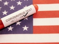 Coronavirus positive test on blood collection tubes on US flag.