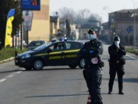 Italian Finance guards (Guardia di Finanza) officers patrol by a check-point at the entrance of the small town of Zorlesco, southeast of Milan, on February 24, 2020, situated in the red zone of the COVID-19 the novel coronavirus outbreak in northern Italy. - Italy, the country with the most confirmed …