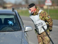 An Italian Army soldier talks with a driver at a cordoned areas' check-point, few kilometers from the small town of Castiglione d'Adda, southeast of Milan, on February 27, 2020 amid fears over the spread of the novel Coronavirus. - The number of COVID-19 infections in Italy, the hardest hit country …